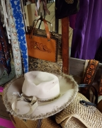 A decorated hat or leather purse?