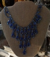 Blue rhinestone necklace adds color.